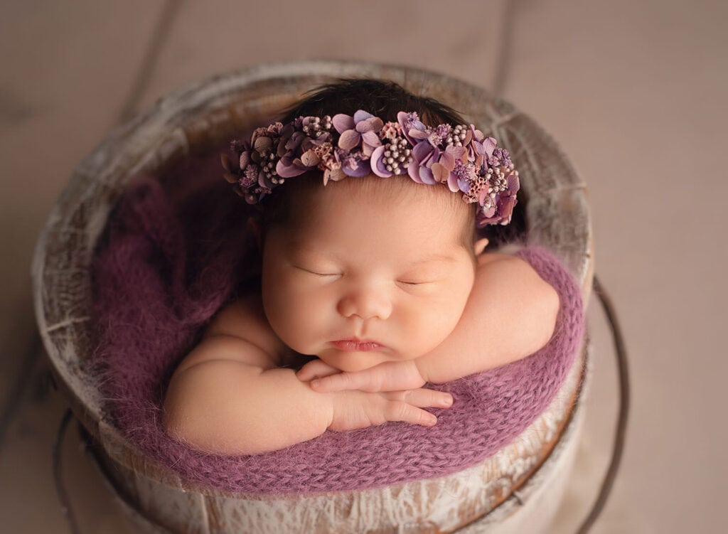 newborn baby in lavender and moss halo