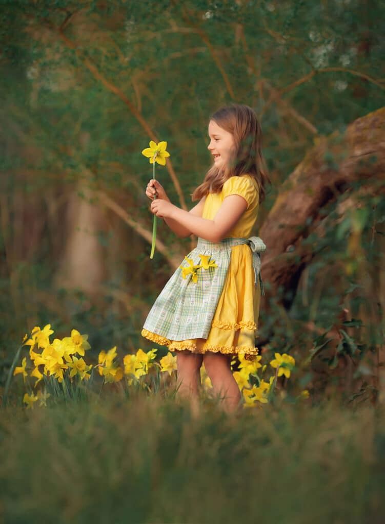 6 year old picking daffodils