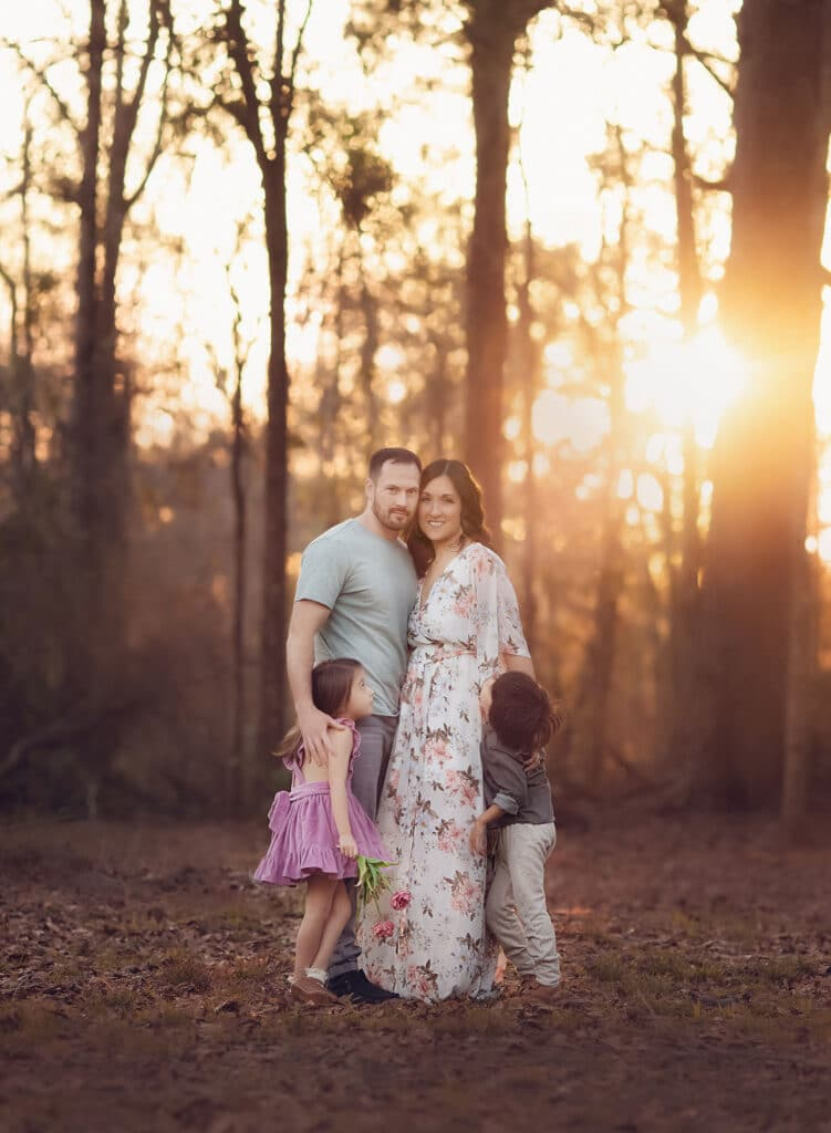 family of four at sunset