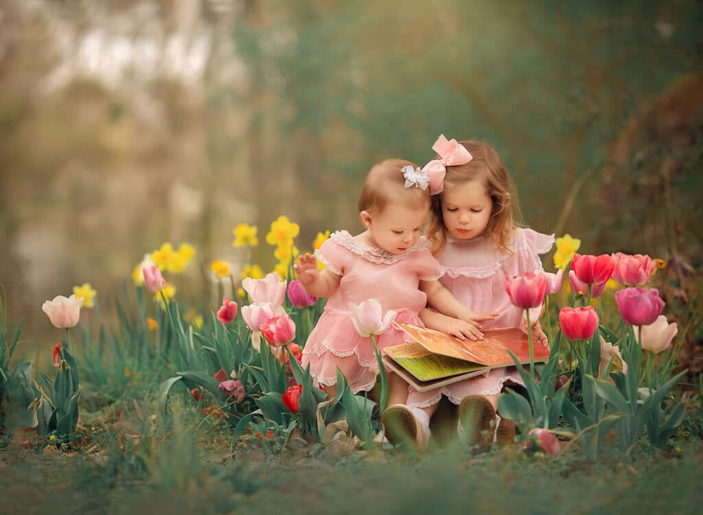 Fine art photo of sisters in tulips