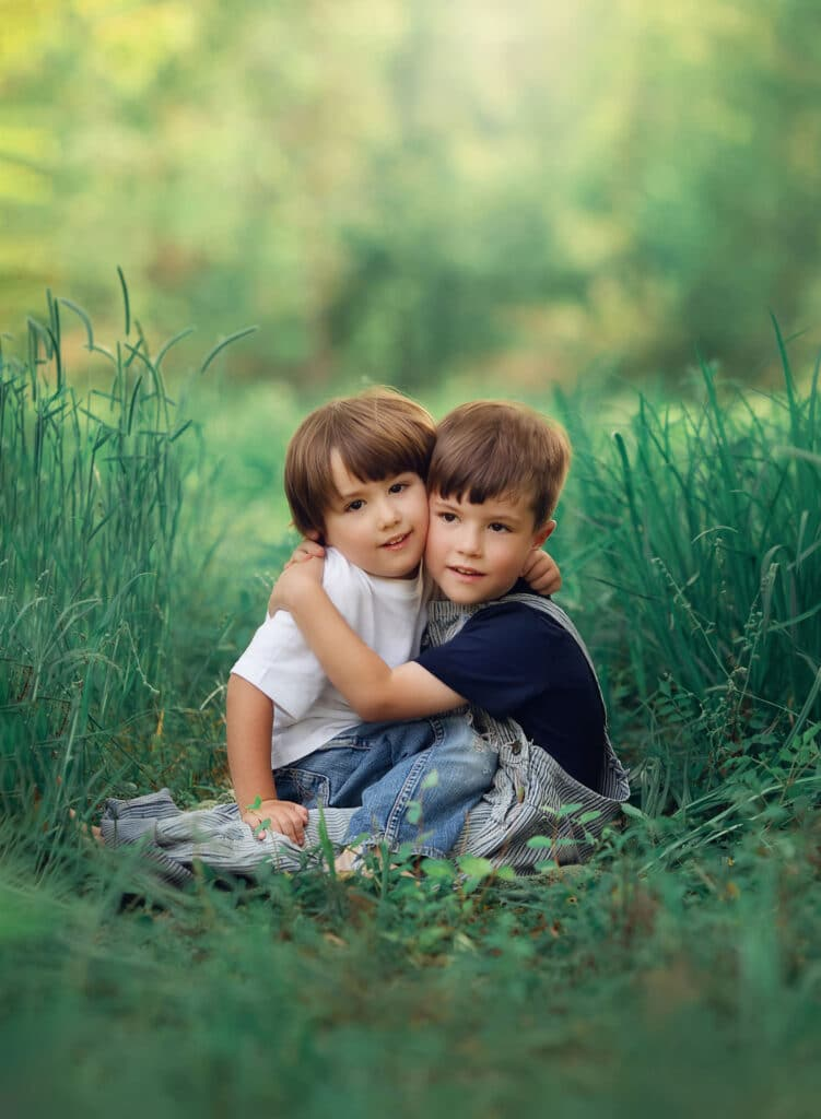 brothers hugging in grass