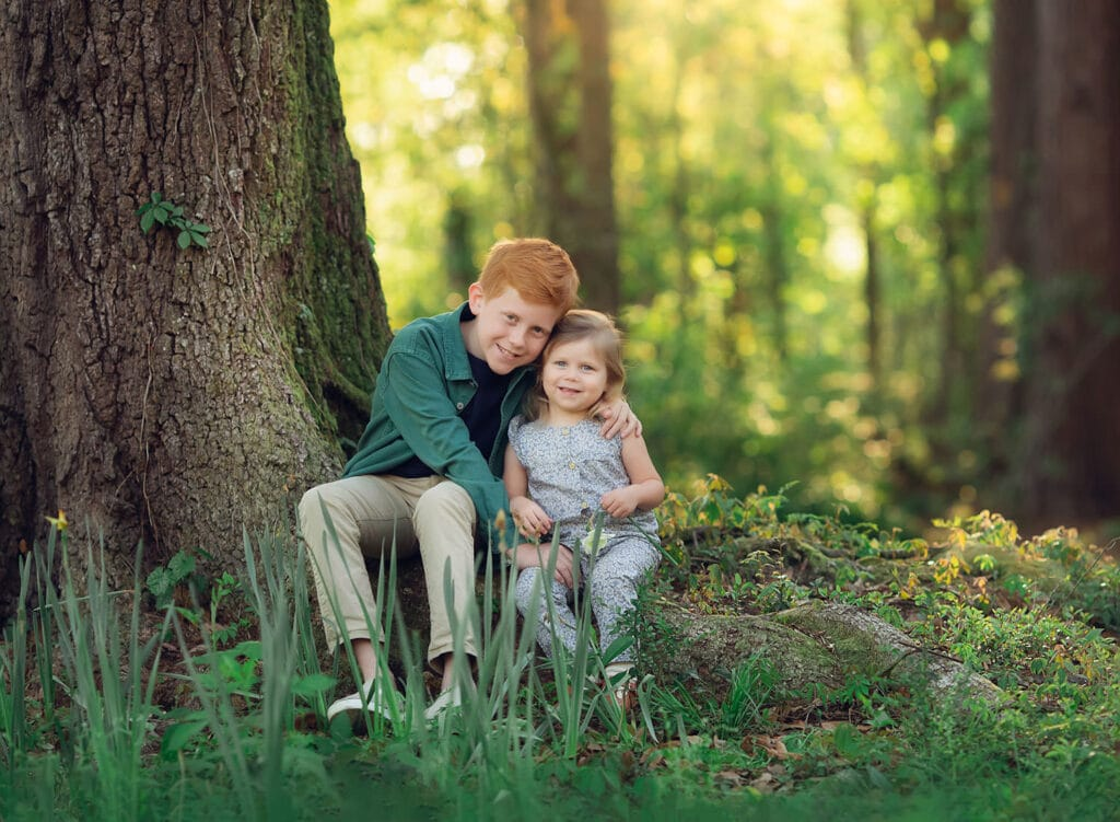 brother and sister on big oak tree