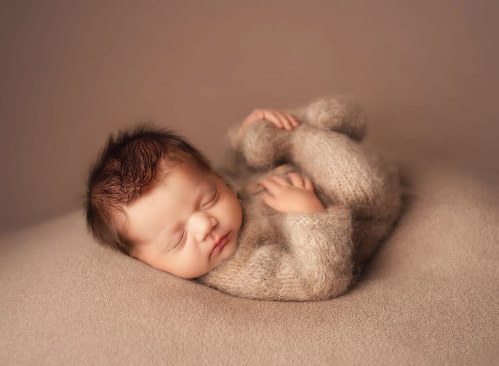 Newborn boy in knit outfit