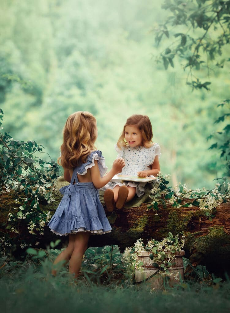 fine art photos of sisters reading book