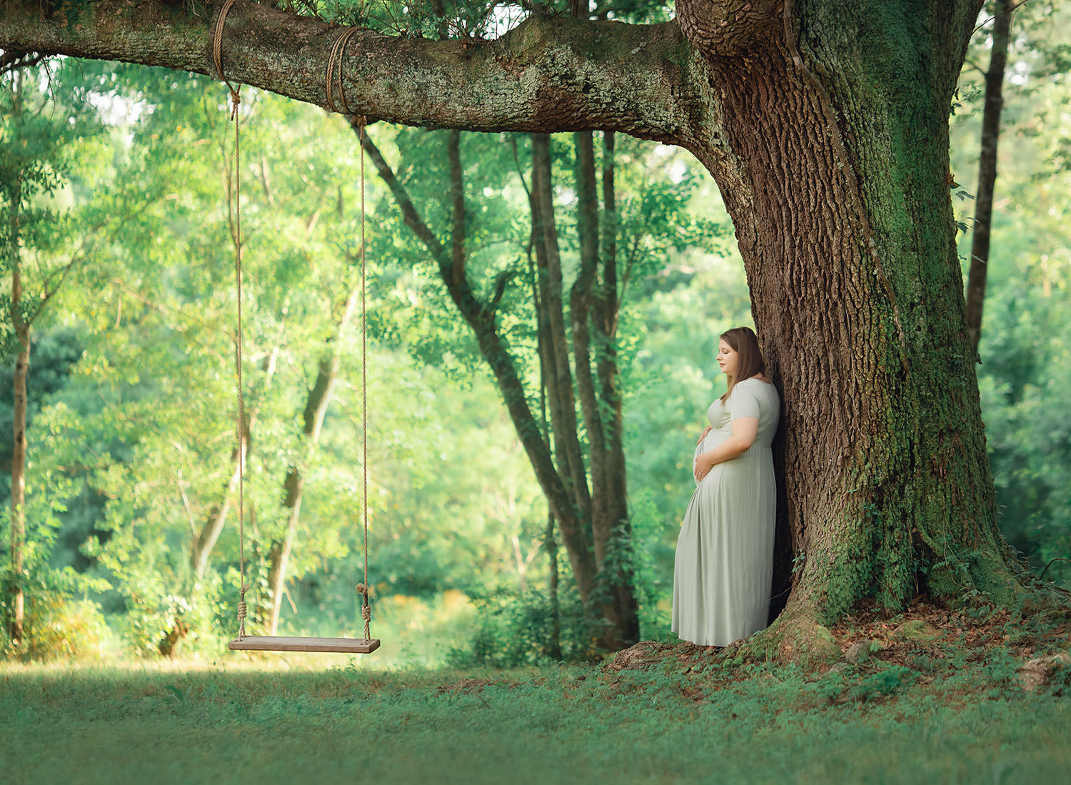 momma to be by tree swing