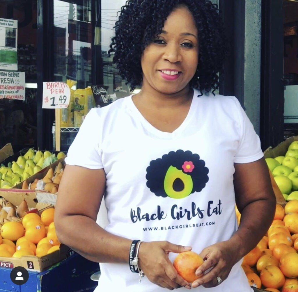Photo of LA Dunn. She offers plant-based coaching at Black Girls Eat.