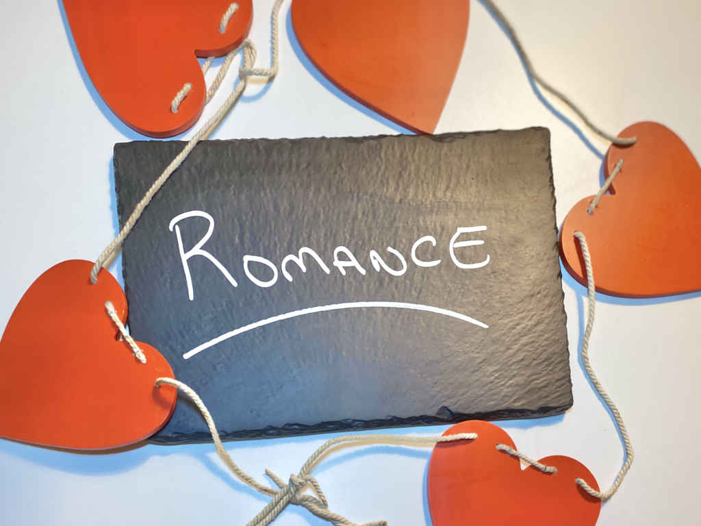 Chalk Slate with the Word Romance on it