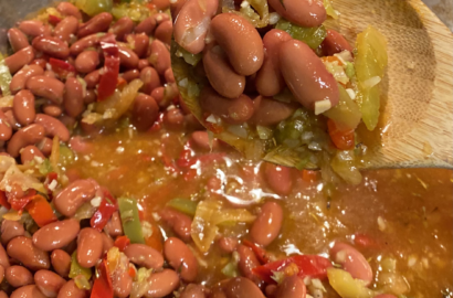 Red Beans with Peppers, Onions and other seasonings in Skillet on Stove
