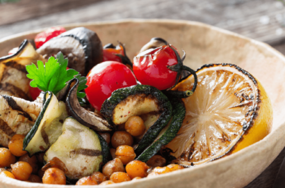 Bowl of veggies including zucchini, tomatoes and chick peas