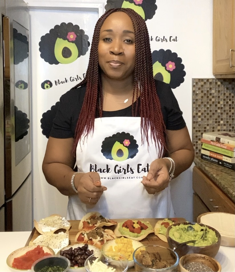 Plant based advocate LA Dunn in the kitchen with an assortment of tostadas