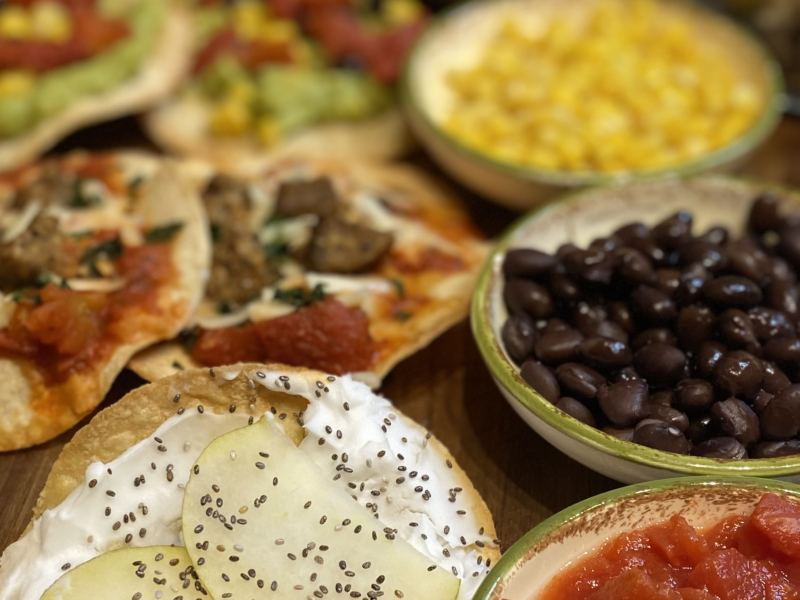 Corn Tostadas and corn, beans, diced tomatoes, pear, vegan cream cheese and chia seeds