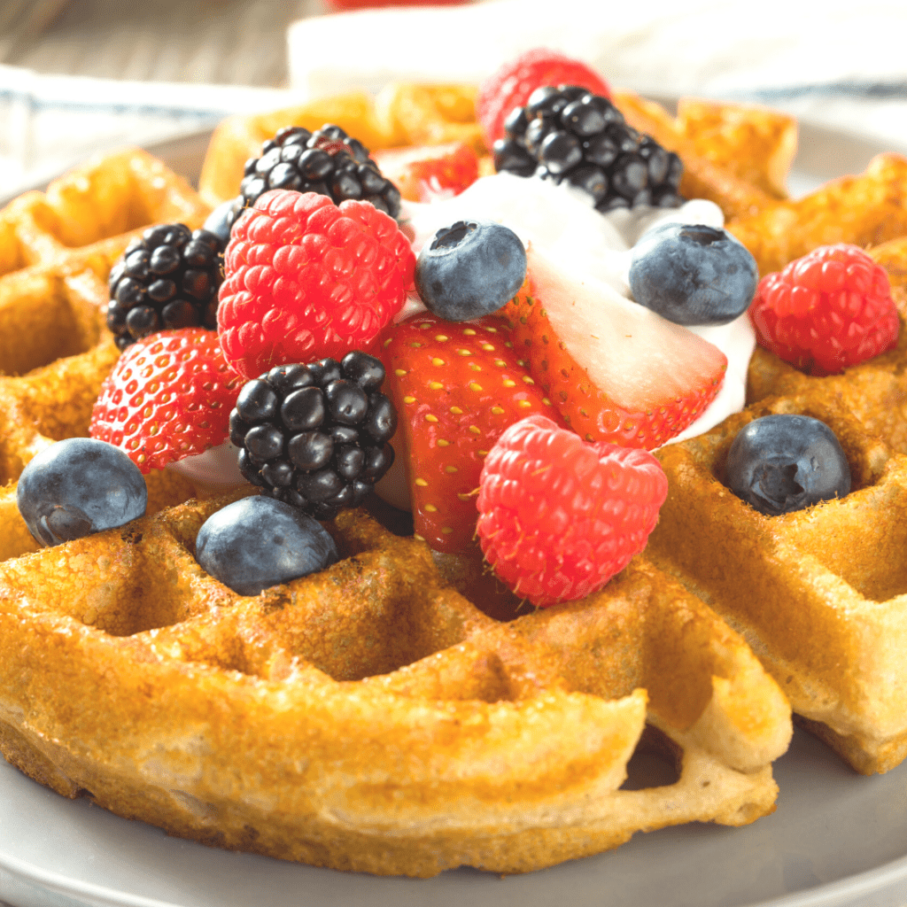 Belgian style waffles with fruit on a plate