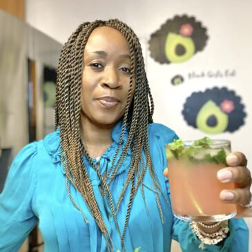 Woman holding a paloma cocktail