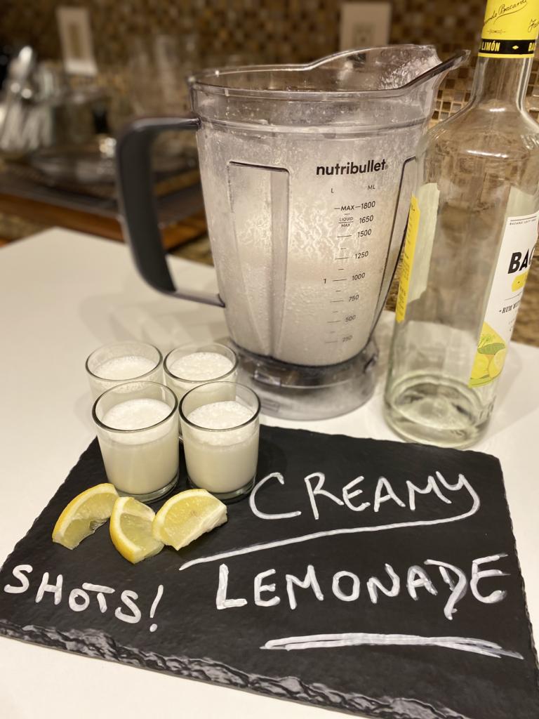 Creamy Lemonade in shot glasses with lemon flavored rum added