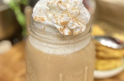 Pumpkin Spice Latte with Whipped Cream on Top in a Mason Jar