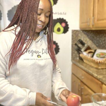 Woman preparing to slice an apple