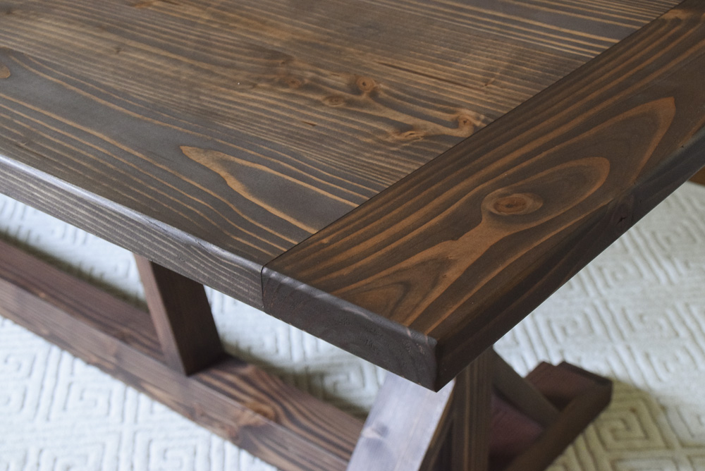 modern rustic farmhouse table made of fir with brown finish