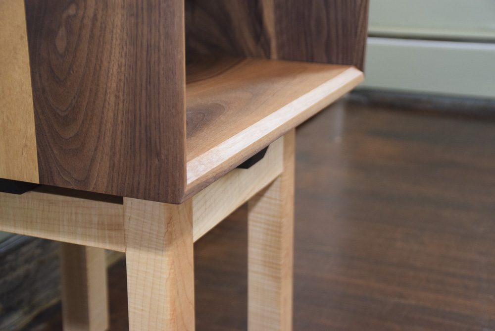 chamfer detail of the walnut and maple open end table