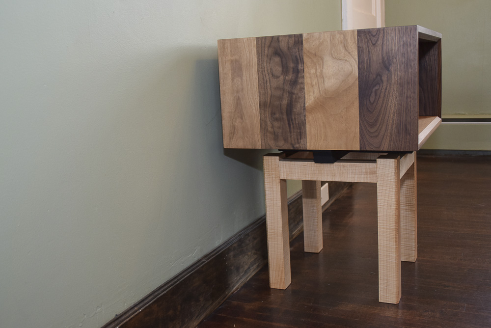 side view of the walnut and maple open end table