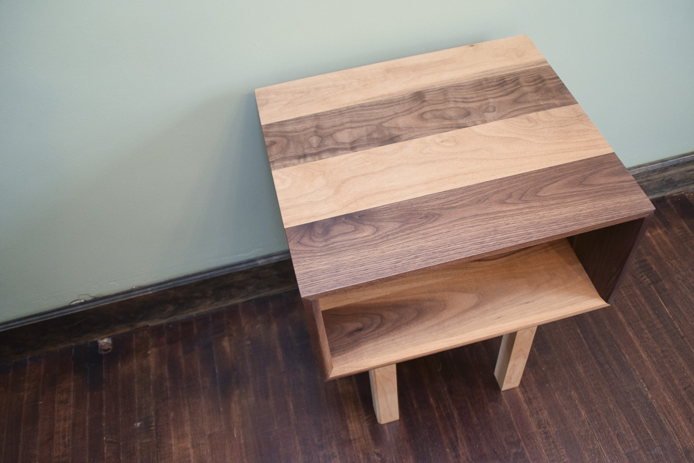 top view of the walnut and maple open end table