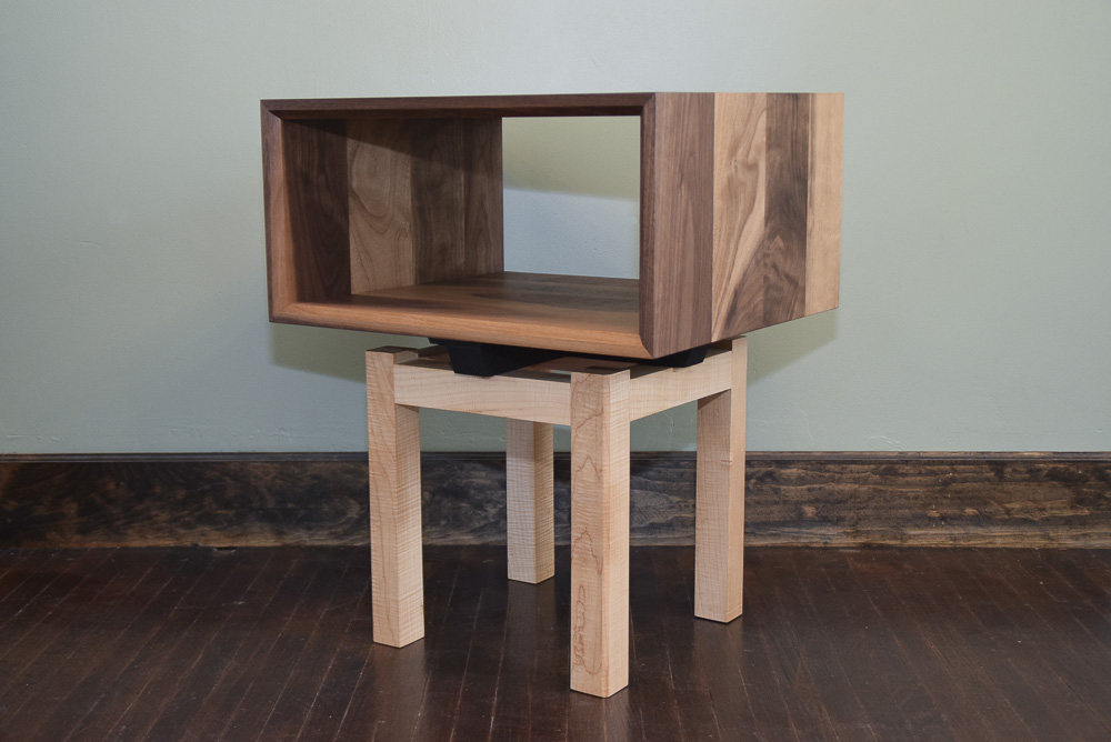 angle view of the walnut and maple open end table
