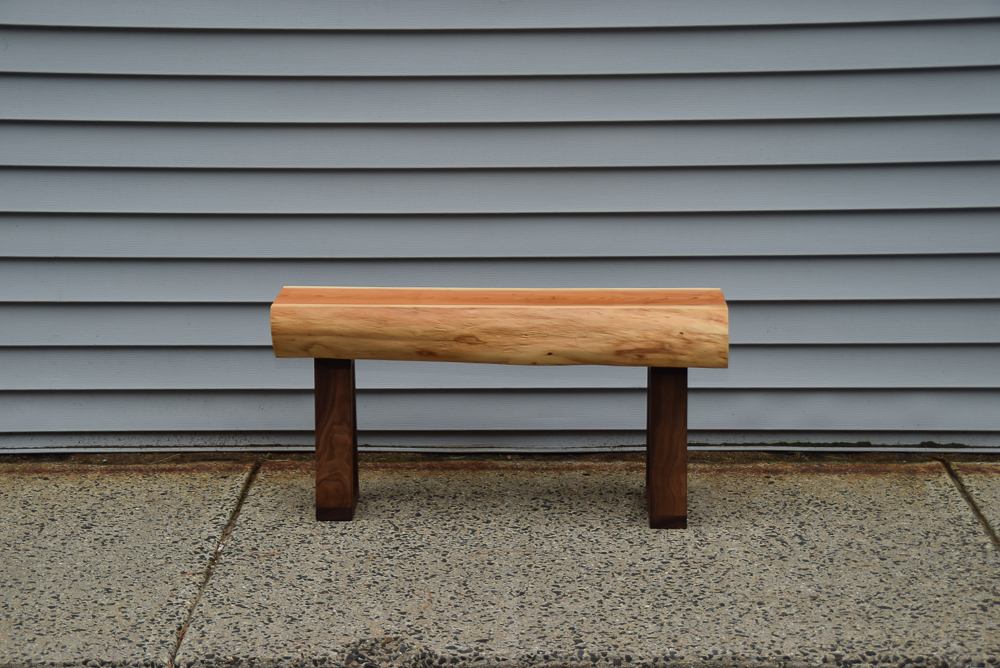 live edge yew bench with walnut legs viewed from the side