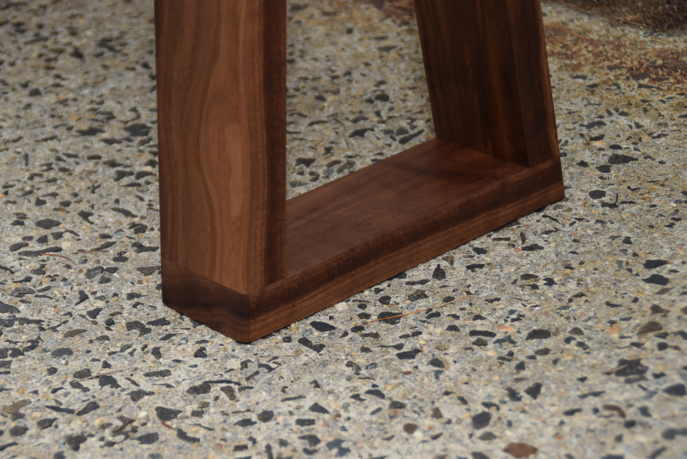 close up of yew bench walnut legs