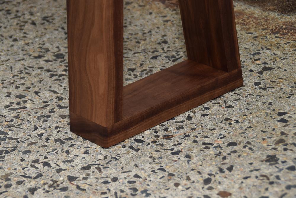 close up of yew bench walnut legs