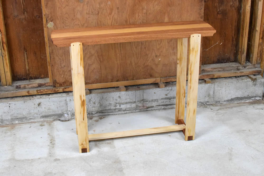 Angled view of Mahogany and Maple Console Table