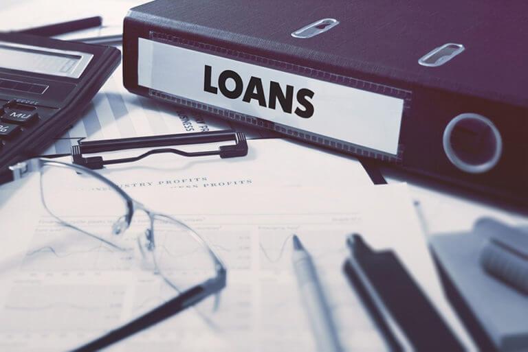 Loans on Ring Binder. Blured, Toned Image.