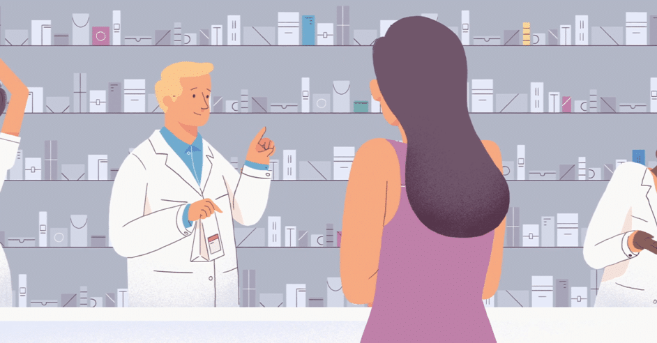 Pharmacist helping patient at the pharmacy counter