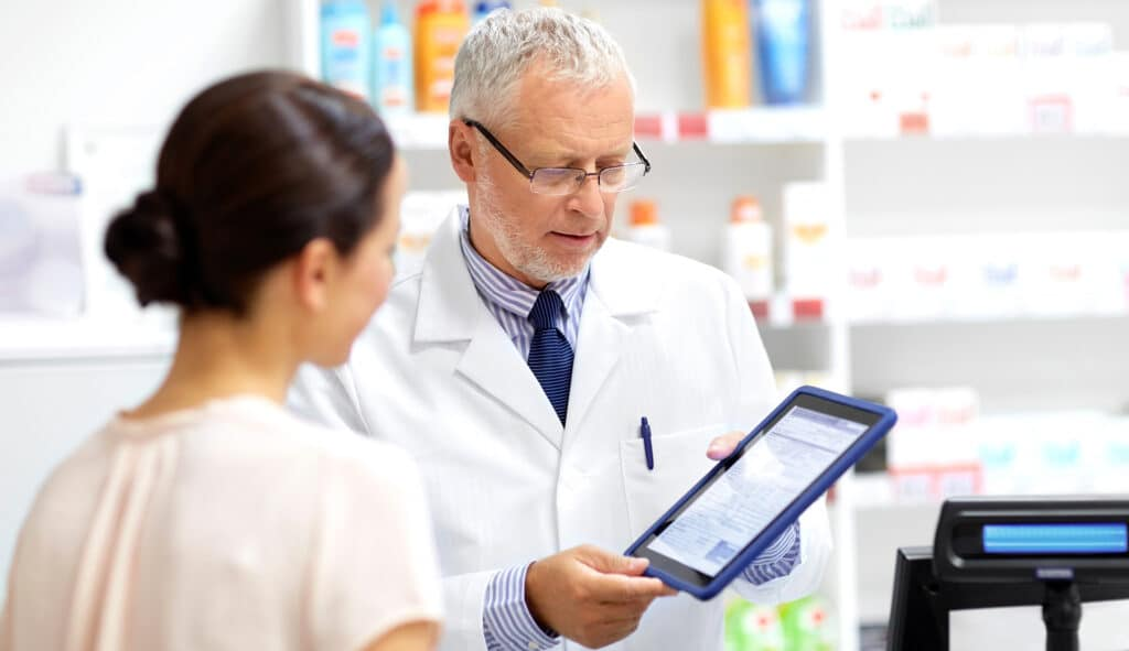 Pharmacist with Patient on Tablet.jpg