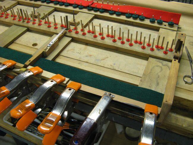 Installing new felts on key frame