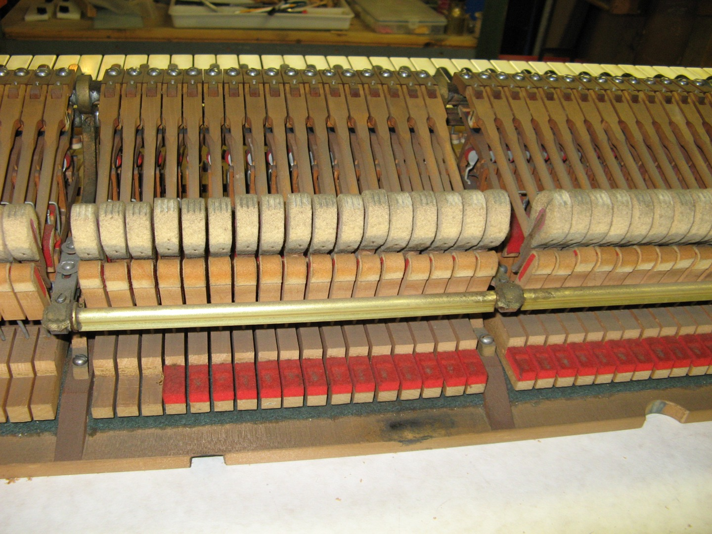 Worn hammers on a grand piano