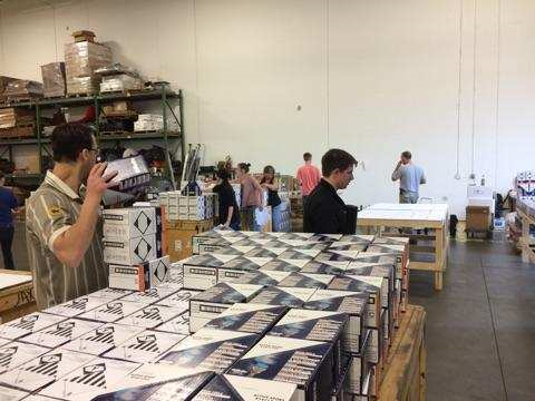 People sorting boxes
