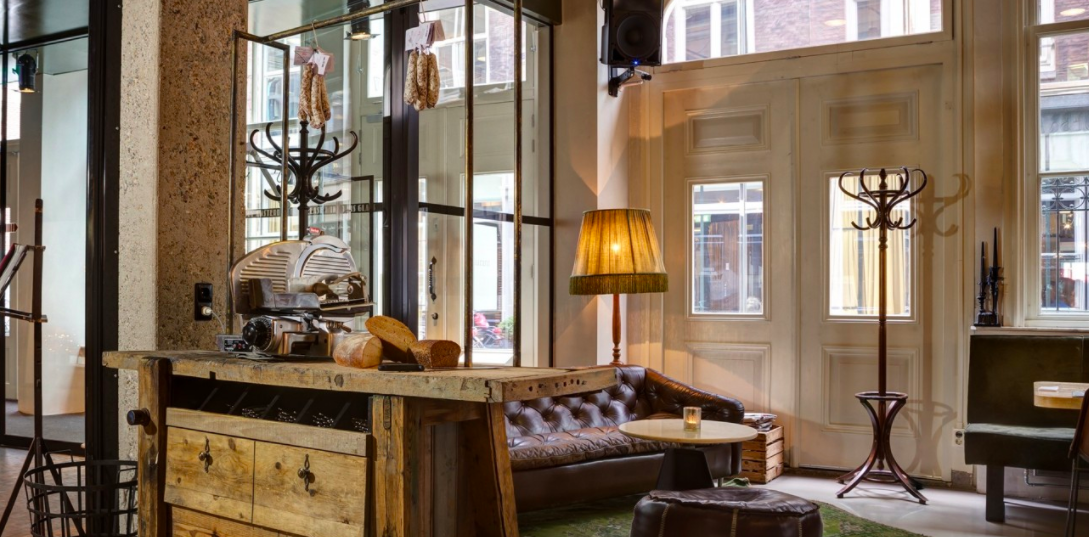 hotel V lobby - Hotel V has 3 locations in Amsterdam, all have a cozy modern style with lots of wood and leather touches. Each one is an excellent choice for quality accommodations in Amsterdam.