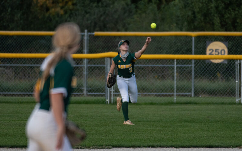 Senior outfielder Maddie Snider passes a ball at the RBHS softball game Wednesday, Sept. 23. Photo by Ana Manzano.