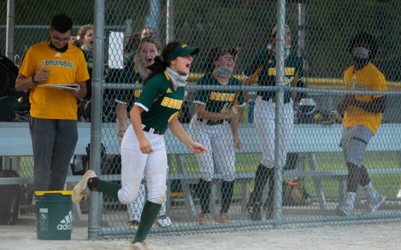 The Bruins bench celebrates after senior outfielder Maddie Snider makes a pass to sophomore catcher Abby Hay at the RBHS softball game Wednesday, Sept. 23. Photo by Ana Manzano.