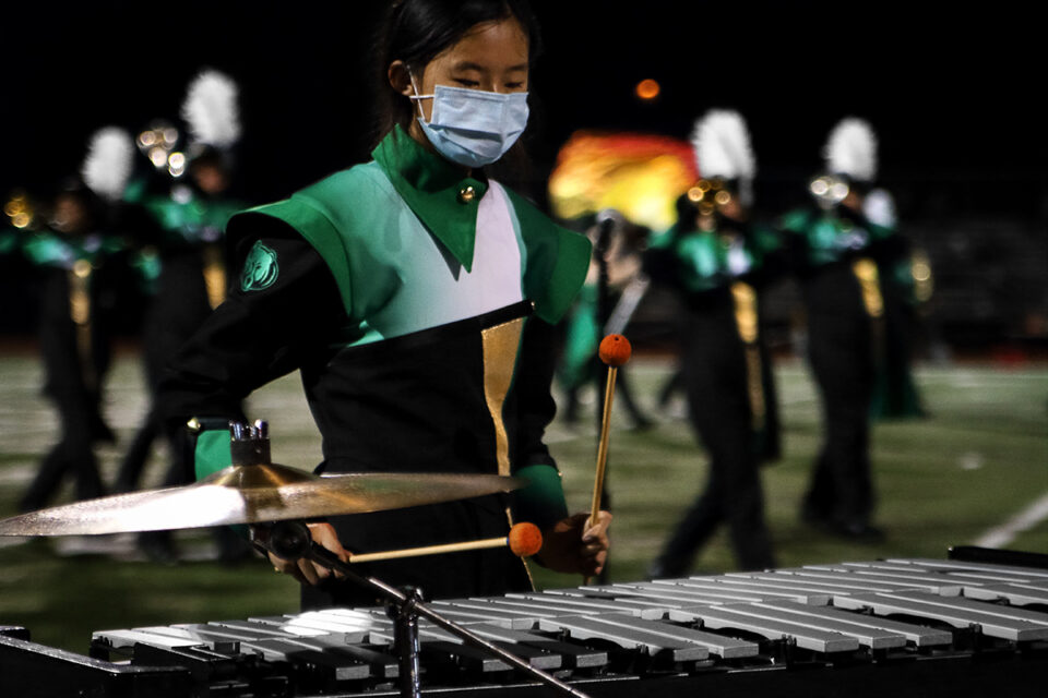 Freshman Rachel Wu playing the xylophone during Rock Bridge band's halftime performance. Photo by Desmond Kisida.