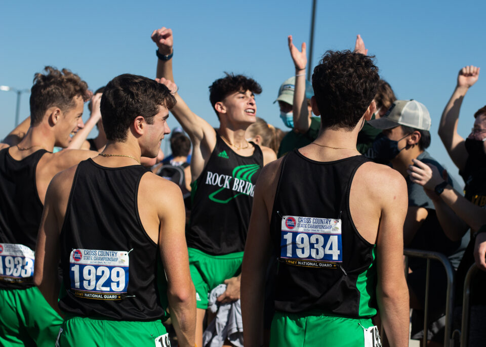 Wearing number 1929, senior Matthew Hauser celebrates his Missouri State High School Activities Association (MSHAA) state championship victory with his teammates and classmates in the crowd. Hauser's point contribution pushed the RBHS boys team to first place in a tense meet.