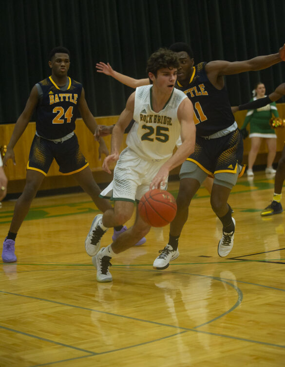 Junior Nick Arndt dribbles the ball away from Senior BHS defender Maricus Grant Tuesday, Dec. 7. Photo by Ana Manzano.