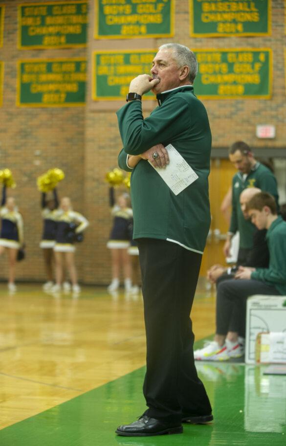 Head varsity coah Jim Scanlon watches the game intently Tuesday, Dec. 7. Photo by Ana Manzano.