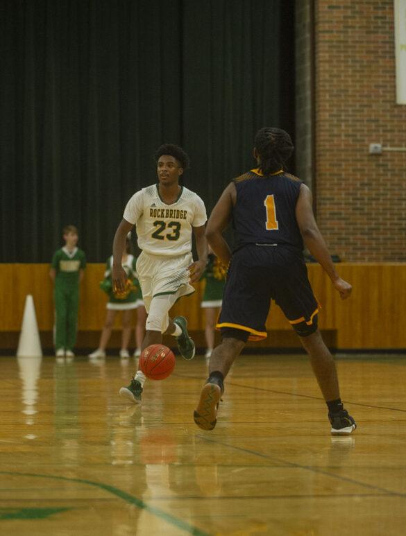 Senior Charles Wilson takes on a BHS defender at the boys' varsity basketball Tuesday, Dec. 7. Photo by Ana Manzano.