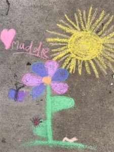 French teacher Kristin Reed and her daughter's sidewalk art. Photo by Kristin Reed.