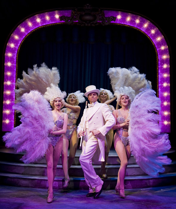 "Brent Barrett as Benjamin Stone (center) performs ""Live, Laugh, Love"" with showgirls Jenny Guse, Christina Myers, Amanda Tanguay and Amanda Kroiss in Chicago Shakespeare Theater's production of James Goldman and Stephen Sondheim's Follies, directed by Gary Griffin and playing now through November 13, 2011. Photo by Liz Lauren."