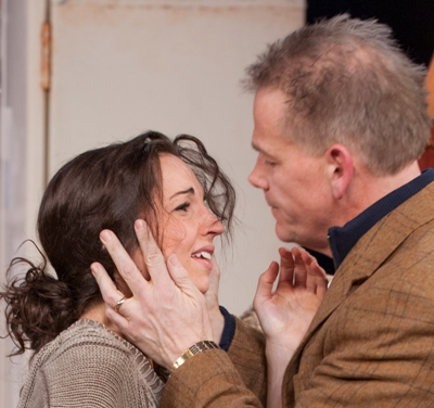 Laura Rook as Kyra and Philip Earl Johnson as Tom find new differences in Skylight by David Hare directed by William Brown at Court Theatre 2013 credit Michael Brosilow