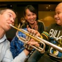 CSO-Principal-trumpet-Chris-Martin-lets-a-young-audience-member-play-a-tune-on-his-trumpet-credit-Todd-Rosenberg