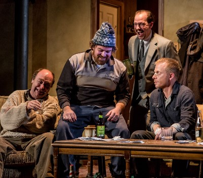 """Everybody's laughing but the troubled Sharky (Dan Waller, right) in this """"Seafarer"""" scene with, from left, Brad Armacost, Ira Amyx and Kevin Theis. (Joe Mazza)"""