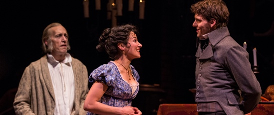Old Ebenezer Scrooge (Larry Yando, left) observes his younger self (Robert Hope) in a happy moment with Belle (Atra Asdou). (Liz Lauren)
