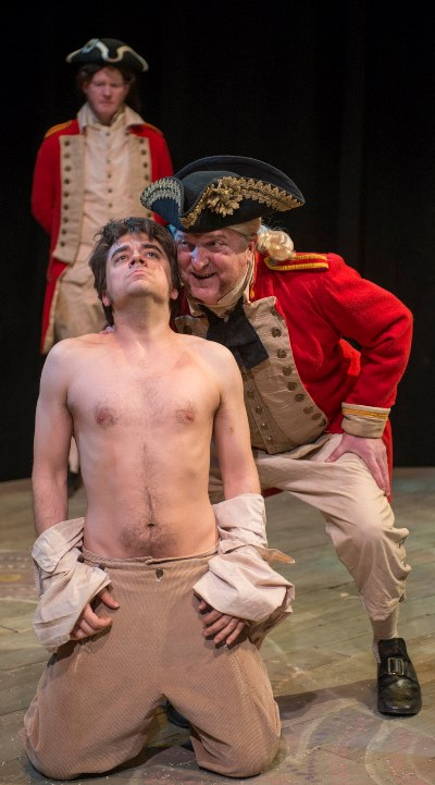 A terrorizing officer (Ben Werling) makes clear this 'actor' (Kevin Viol) is first and last a prisoner in 'Our Country's Good.' (Michael Brosilow)